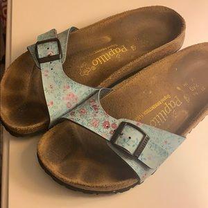 Blue floral Birkenstock sandals.